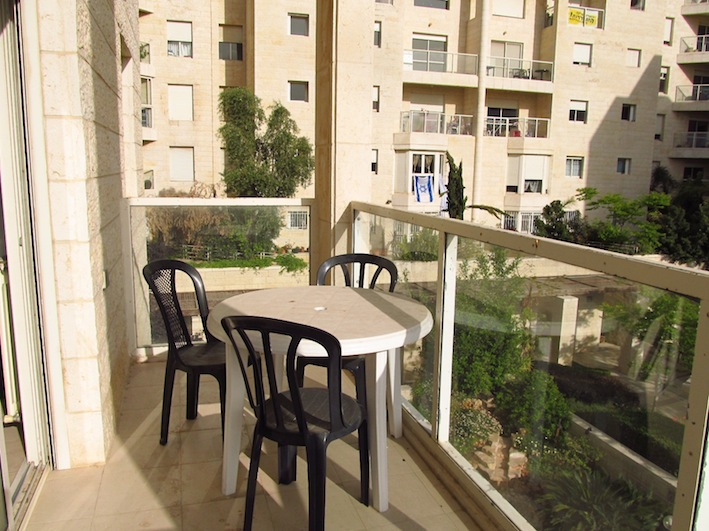 Outdoor table and chairs to enjoy the garden and drink in the Jerusalem air.