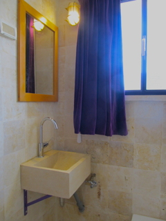 Newly renovated bathroom of Jerusalem Stone, nicely appointed, natural light.